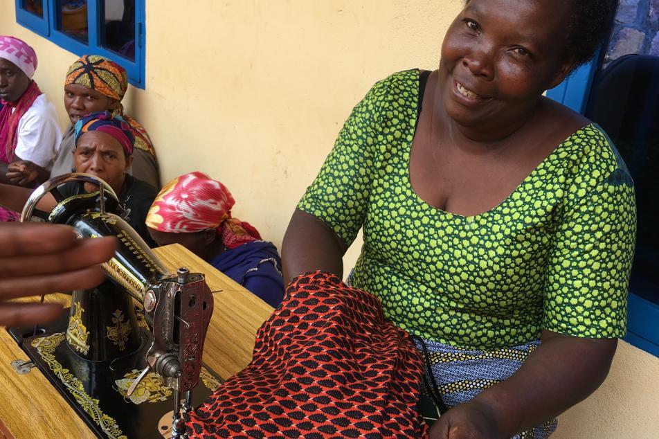 Odette MUREKATETE president at sewing machine
